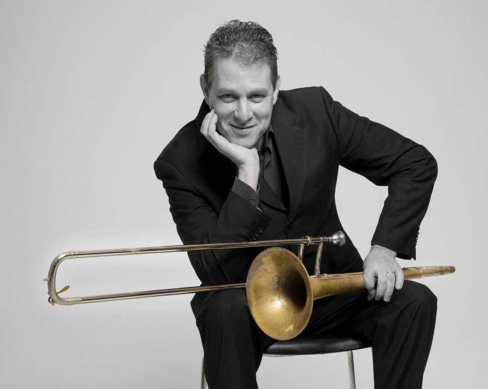 Michael Supnick with trombone in foto studio