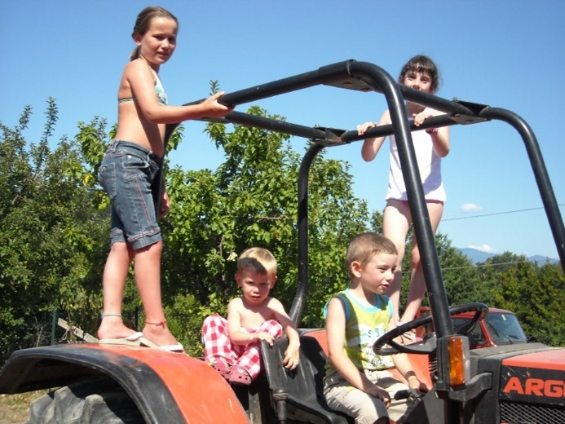 Kids playing on the (tuned off!!) famiglia tractor
