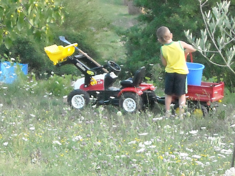 Kid playing with tractor