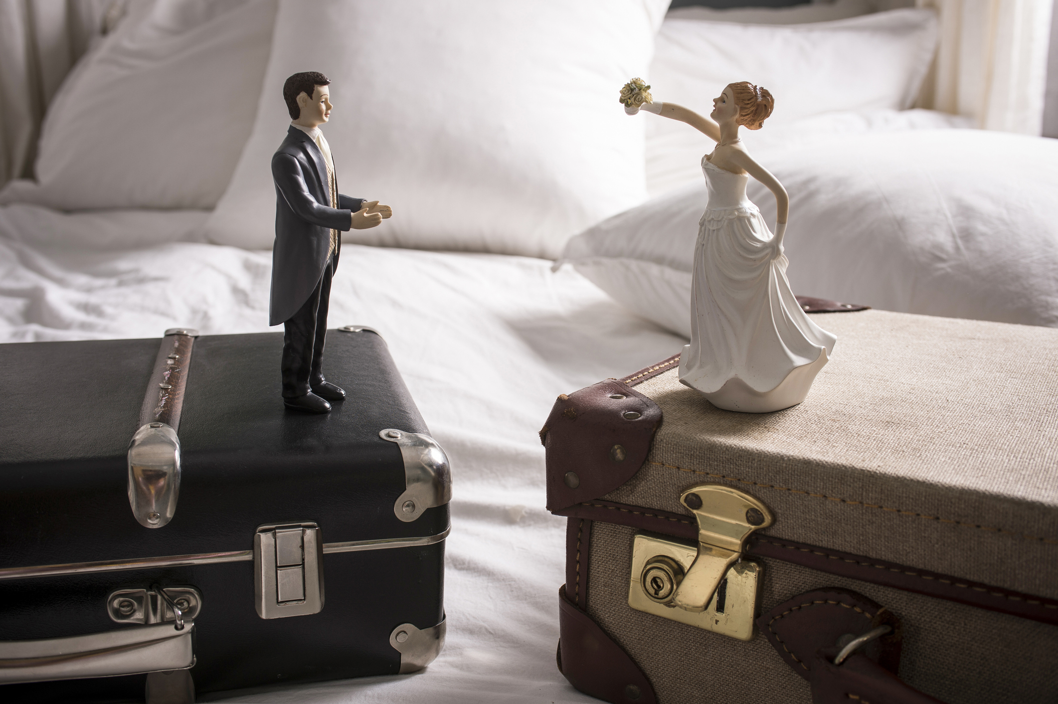 wedding-figurines-on-separate-suitcasesjpg