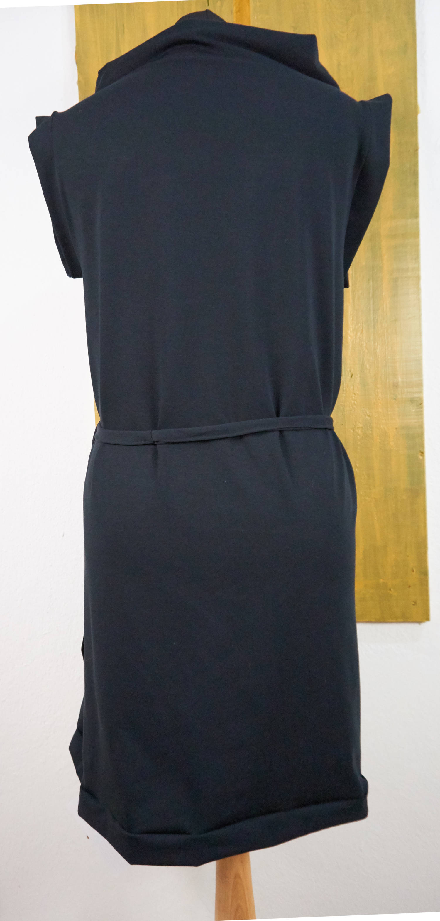sleeveless dress with volcano neck