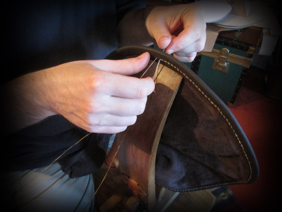 Hand stitching a leather bag