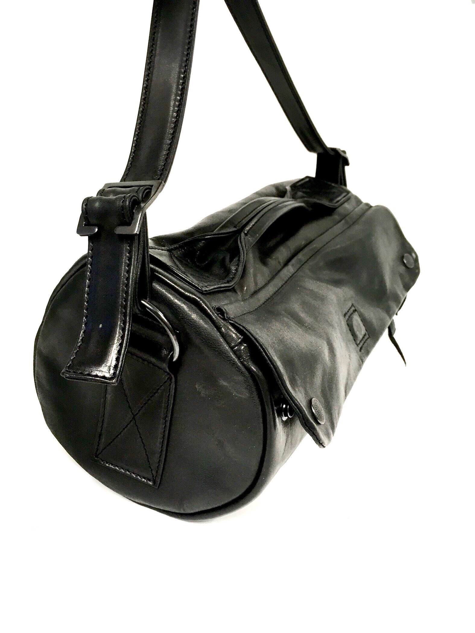 polished barrel bag