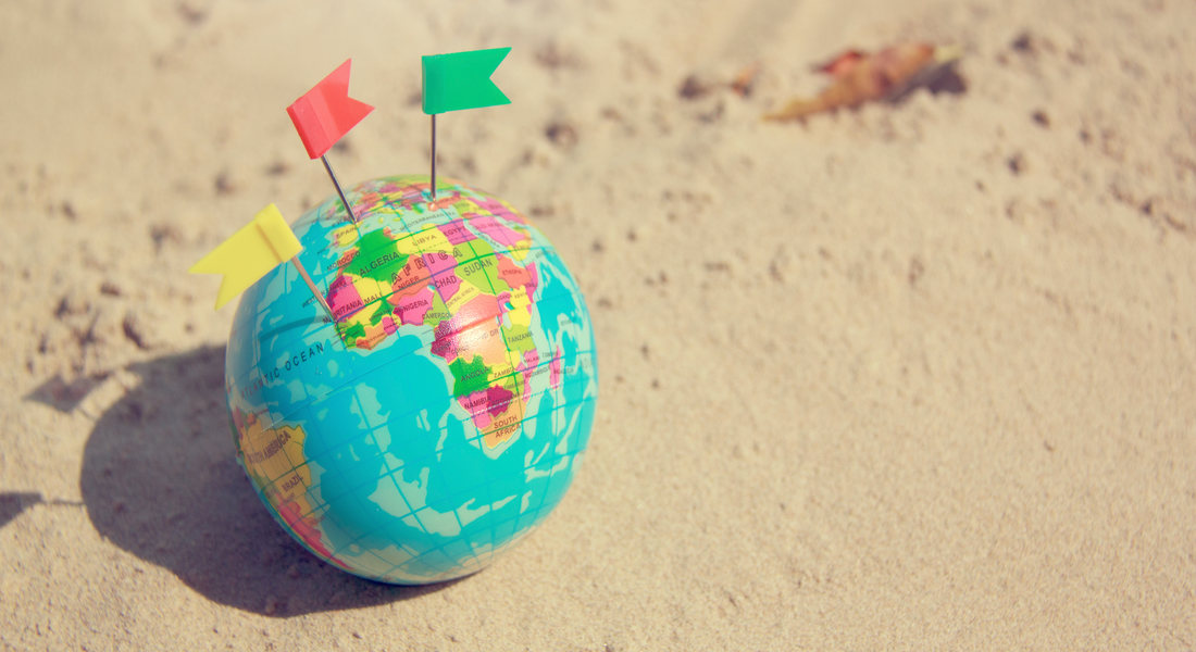 Canva_-_Travel_Summer_Concept_with_Earth_Map_Ball_on_Sand_1100x600_1_optimizedjpg