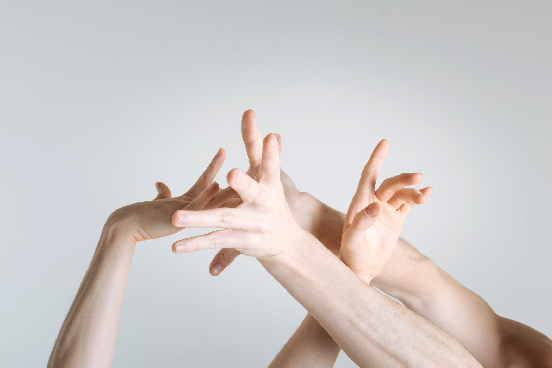 delicate-athletes-hands-demonstrating-interaction-in-the-studiojpg