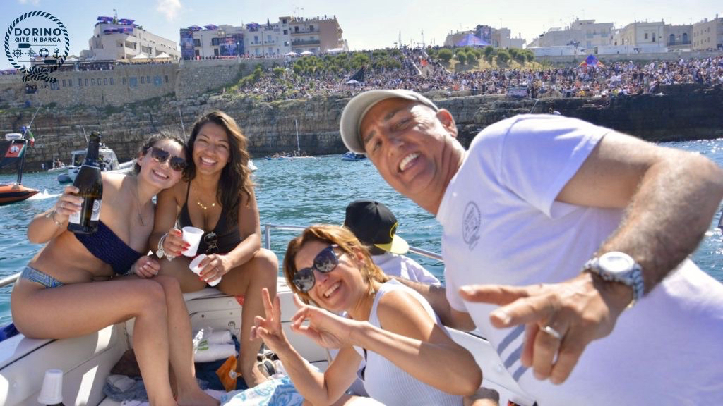Dorino with a group of smiling guests, who attended the RedBull world diving competition